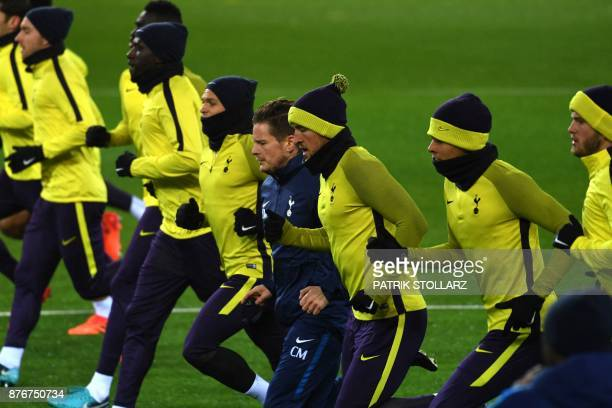 Tottenham Hotspur's players including English striker Harry Kane warm up during a training session on the eve of the Champion's League Group H...