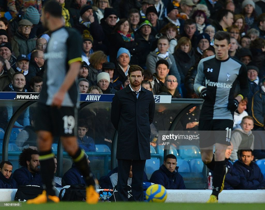 """Tottenham Hotspurs Portuguese manager André Villas-Boas (C) looks on during the FA Cup football match between Leeds United and Tottenham Hotspur at Elland road stadium in Leeds, northern England on January 27, 2013. Leeds won 2-1. AFP PHOTO/ANDREW YATES. RESTRICTED TO EDITORIAL USE. No use with unauthorized audio, video, data, fixture lists, club/league logos or """"live"""" services. Online in-match use limited to 45 images, no video emulation. No use in betting, games or single club/league/player publications."""