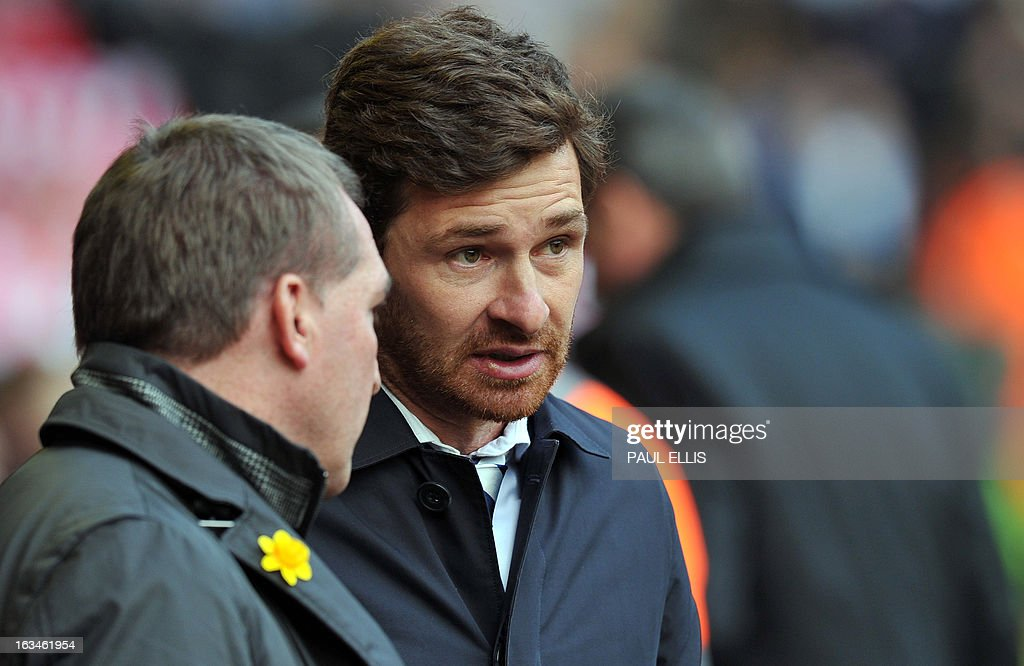 """Tottenham Hotspur's Portuguese manager Andre Villas-Boas (R) and Liverpool manager Brendan Rodgers speak before the English Premier League football match between Liverpool and Tottenham Hotspur at Anfield stadium in Liverpool, northwest England, on March 10, 2013. USE. No use with unauthorized audio, video, data, fixture lists, club/league logos or """"live"""" services. Online in-match use limited to 45 images, no video emulation. No use in betting, games or single club/league/player publications."""