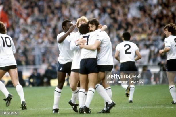 Tottenham Hotspur's Ricardo Villa celebrates scoring the opening goal with teammates Osvaldo Ardiles Steve Archibald and Garth Crooks