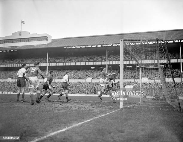 Tottenham Hotspur's rightback Alf Ramsey lost this goalline duel with an Everton forward John Parker which saw the visitor's score their first goal...