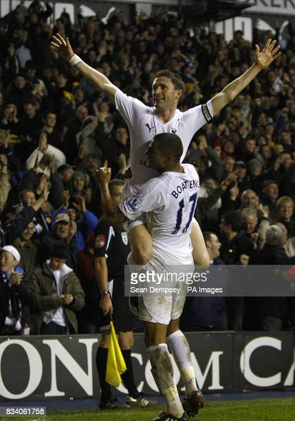 Tottenham Hotspur's Robbie Keane celebrates scoring his sides second goal with teammate KevinPrince Boateng