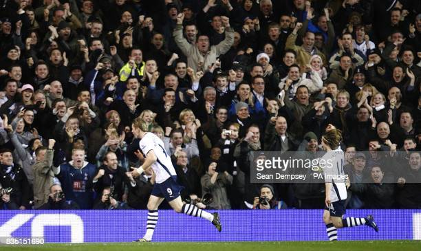 Tottenham Hotspur's Roman Pavlyuchenko celebrates in front of the fans with taem mate Luka Modric after scoring the second goal of the game