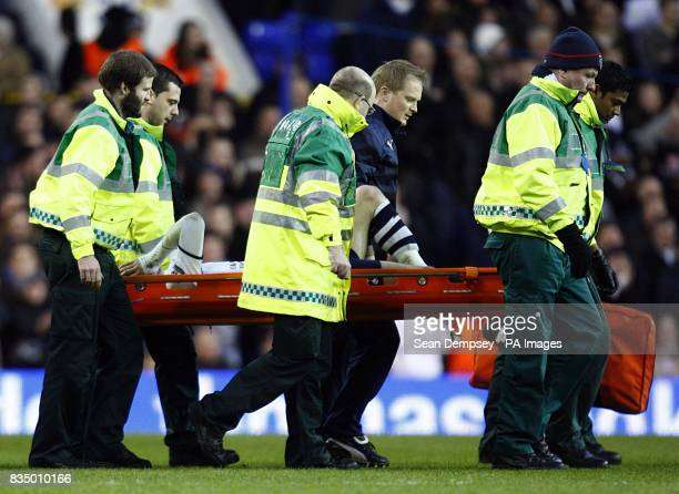 Tottenham Hotspur's Roman Pavlyuchenko is carried off the field after a challenge by Portsmouth's Sean Davis
