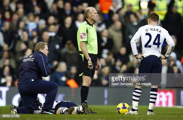 Tottenham Hotspur's Roman Pavlyuchenko lies injured on the ground after a challenge by Portsmouth's Sean Davis
