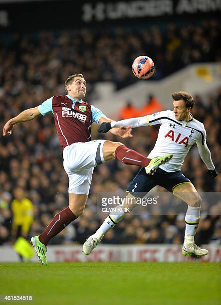 Tottenham Hotspur's Romanian defender Vlad Chiriches vies for the ball with Burnley's English defender Ben Mee during the English FA Cup Third Round...