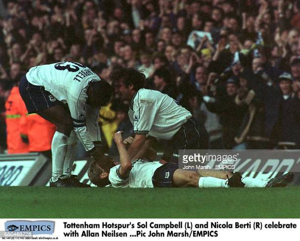 Tottenham Hotspur's Sol Campbell and Nicola Berti celebrate with Allan Neilsen