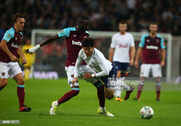 Tottenham Hotspur's Son HeungMin gets browght down by West Ham United's Cheikhou Kouyate during Carabao Cup 4th Round match between Tottenham Hotspur...