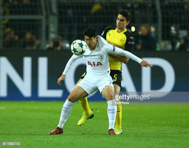 Tottenham Hotspur's Son HeungMin holds of Marc Bartra of Borussia Dortmundduring UEFA Champion League Group H Borussia Dortmund between Tottenham...