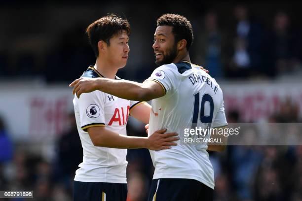 Tottenham Hotspur's South Korean striker Son HeungMin and Tottenham Hotspur's Belgian midfielder Mousa Dembele celebrate on the pitch after the...