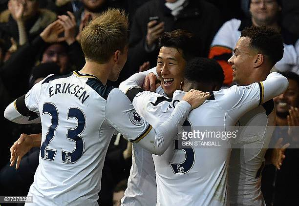 Tottenham Hotspur's South Korean striker Son HeungMin celebrates scoring his team's second goal with Tottenham Hotspur's Argentinian midfielder...
