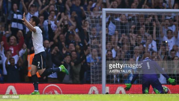 Tottenham Hotspur's South Korean striker Son HeungMin celebrates scoring his team's third goal as Watford's Brazilian goalkeeper Heurelho Gomes...