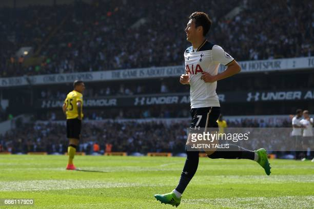 Tottenham Hotspur's South Korean striker Son HeungMin celebrates scoring his team's fourth goal and his second goal during the English Premier League...