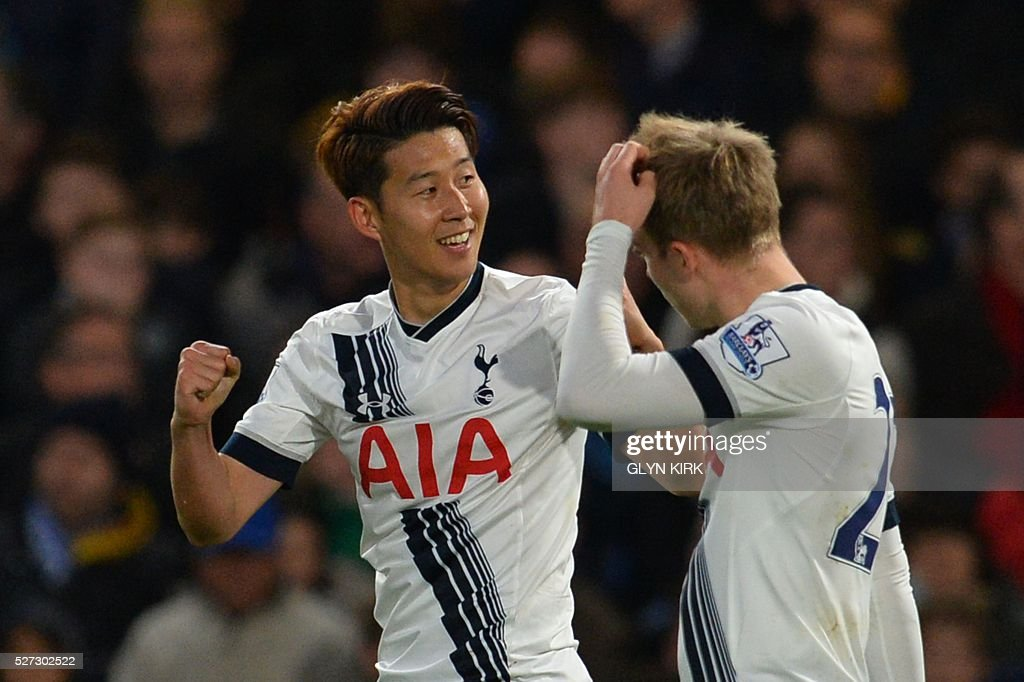 Tottenham Hotspur's South Korean striker Son Heung-Min (L) celebrates scoring their second goal during the English Premier League football match between Chelsea and Tottenham Hotspur at Stamford Bridge in London on May 2, 2016. / AFP / GLYN KIRK / RESTRICTED TO EDITORIAL USE. No use with unauthorized audio, video, data, fixture lists, club/league logos or 'live' services. Online in-match use limited to 75 images, no video emulation. No use in betting, games or single club/league/player publications. /
