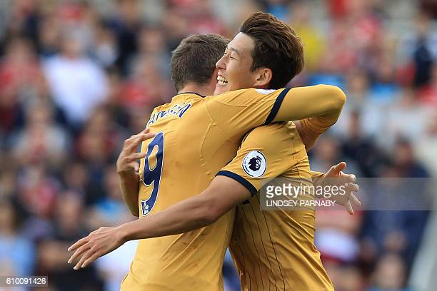 Tottenham Hotspur's South Korean striker Son HeungMin celebrates with Tottenham Hotspur's Dutch striker Vincent Janssen after scoring his team's...