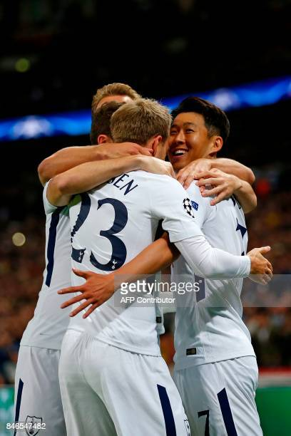 Tottenham Hotspur's South Korean striker Son HeungMin celebrates with teammates after scoring the opening goal of the UEFA Champions League Group H...