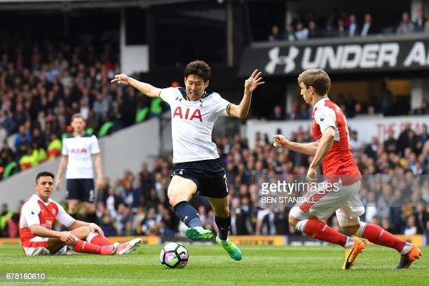 Tottenham Hotspur's South Korean striker Son HeungMin controls the ball during the English Premier League football match between Tottenham Hotspur...