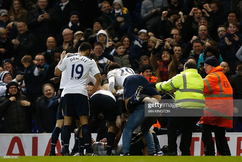 Tottenham Hotspur's South Korean striker Son Heung-Min is mobbed by teammates and fan after scores his team's third goal during the English FA Cup fourth round football match between Tottenham Hotspur and Wycombe Wanderers at White Hart Lane in London, on January 28, 2017. Tottenham won the match 4-3. / AFP / Ian KINGTON / RESTRICTED TO EDITORIAL USE. No use with unauthorized audio, video, data, fixture lists, club/league logos or 'live' services. Online in-match use limited to 75 images, no video emulation. No use in betting, games or single club/league/player publications. /