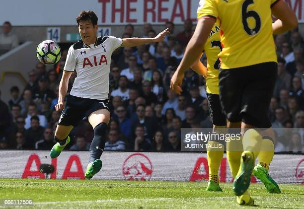 Tottenham Hotspur's South Korean striker Son HeungMin prpepares to volley the ball to score his team's fourth and his second goal during the English...