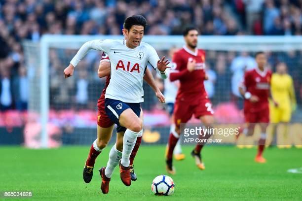 Tottenham Hotspur's South Korean striker Son HeungMin runs with the ball during the English Premier League football match between Tottenham Hotspur...