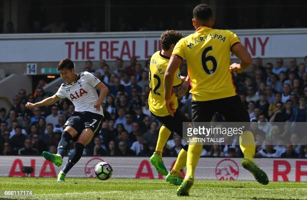 Tottenham Hotspur's South Korean striker Son HeungMin scores his team's fourth and his second goal during the English Premier League football match...
