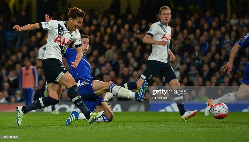 Tottenham Hotspur's South Korean striker Son Heung-Min (L) scores their second goal during the English Premier League football match between Chelsea and Tottenham Hotspur at Stamford Bridge in London on May 2, 2016. / AFP / GLYN KIRK / RESTRICTED TO EDITORIAL USE. No use with unauthorized audio, video, data, fixture lists, club/league logos or 'live' services. Online in-match use limited to 75 images, no video emulation. No use in betting, games or single club/league/player publications. /