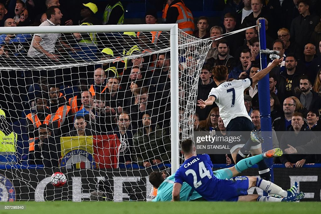 Tottenham Hotspur's South Korean striker Son Heung-Min (R) scores their second goal during the English Premier League football match between Chelsea and Tottenham Hotspur at Stamford Bridge in London on May 2, 2016. / AFP / BEN STANSALL / RESTRICTED TO EDITORIAL USE. No use with unauthorized audio, video, data, fixture lists, club/league logos or 'live' services. Online in-match use limited to 75 images, no video emulation. No use in betting, games or single club/league/player publications. /