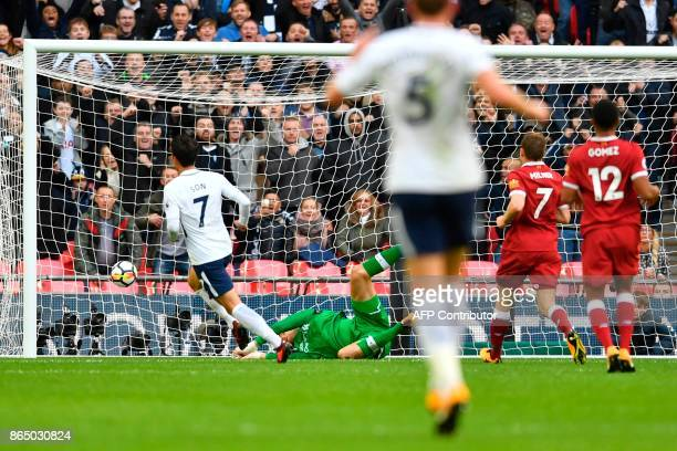 Tottenham Hotspur's South Korean striker Son HeungMin scores their second goal past Liverpool's Belgian goalkeeper Simon Mignolet during the English...