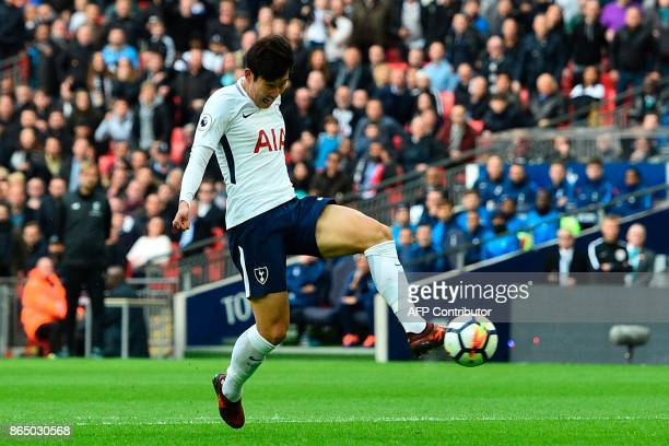 Tottenham Hotspur's South Korean striker Son HeungMin shoots to score their second goal during the English Premier League football match between...
