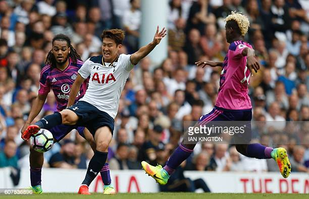 Tottenham Hotspur's South Korean striker Son HeungMin vies with Sunderland's Dutch defender Jason Denayer and Sunderland's Gabonese midfielder Didier...