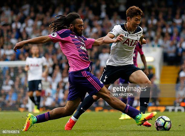 Tottenham Hotspur's South Korean striker Son HeungMin vies with Sunderland's Dutch defender Jason Denayer during the English Premier League football...