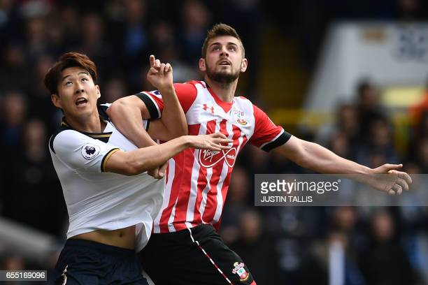 Tottenham Hotspur's South Korean striker Son HeungMin vies with Southampton's Irish striker Shane Long during the English Premier League football...