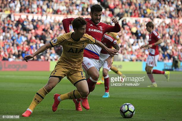 Tottenham Hotspur's South Korean striker Son HeungMin vies with Middlesbrough's Spanish defender Antonio Barragan during the English Premier League...