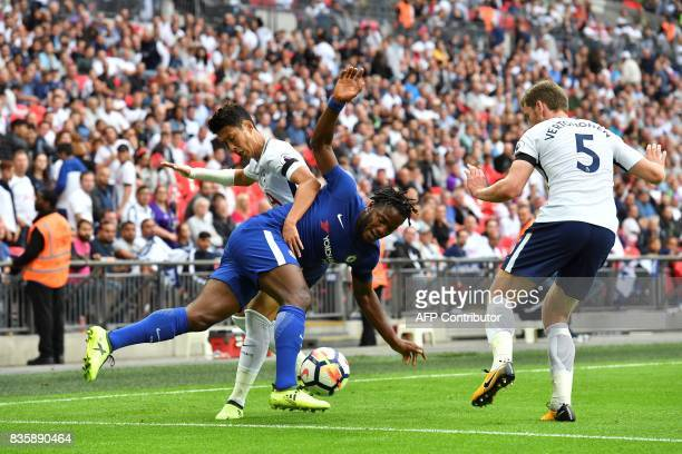 Tottenham Hotspur's South Korean striker Son HeungMin vies with Chelsea's Belgian striker Michy Batshuayi during the English Premier League football...