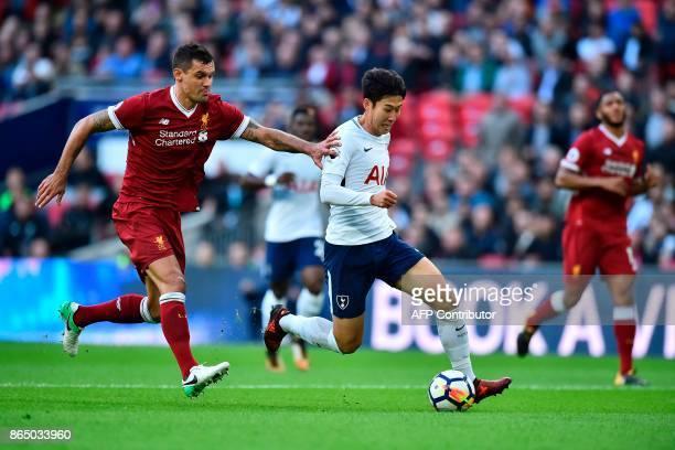 Tottenham Hotspur's South Korean striker Son HeungMin vies with Liverpool's Croatian defender Dejan Lovren during the English Premier League football...