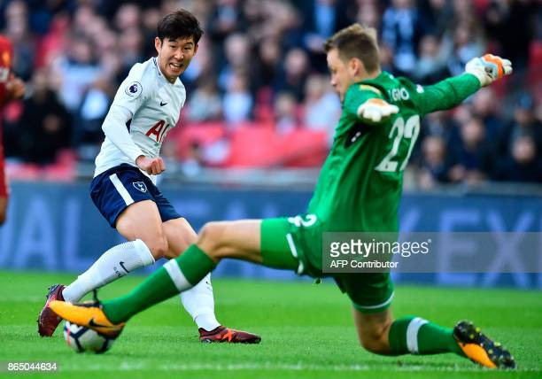 Tottenham Hotspur's South Korean striker Son HeungMin vies with Liverpool's Belgian goalkeeper Simon Mignolet during the English Premier League...