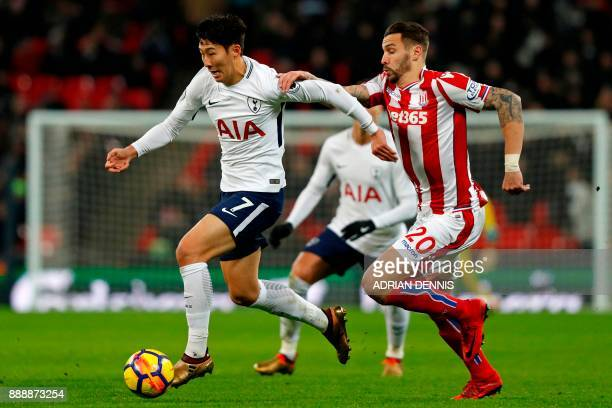 Tottenham Hotspur's South Korean striker Son HeungMin vies with Stoke City's US defender Geoff Cameron during the English Premier League football...