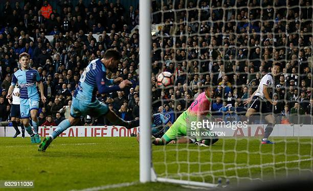 Tottenham Hotspur's South Korean striker Son HeungMin watches his cross deflect into the goal off of Wycombe Wanderers' Welsh defender Joe Jacobson...
