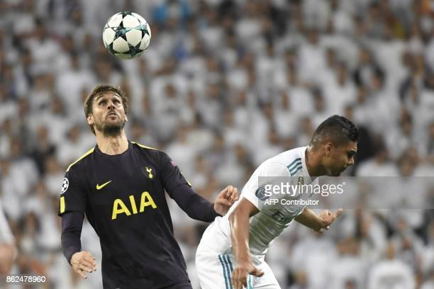 Tottenham Hotspur's Spanish striker Fernando Llorente heads the ball next to Real Madrid's Brazilian midfielder Casemiro during the UEFA Champions...