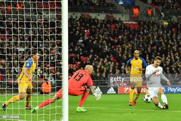 Tottenham Hotspur's Spanish striker Fernando Llorente shoots past Apoel Nicosia's Spanish goalkeeper Nauzet Perez to score the opening goal of the...