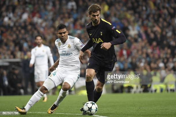 Tottenham Hotspur's Spanish striker Fernando Llorente vies with Real Madrid's Brazilian midfielder Casemiro during the UEFA Champions League group H...