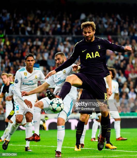 Tottenham Hotspur's Spanish striker Fernando Llorente vies with Real Madrid's French forward Karim Benzema and Real Madrid's French defender Raphael...