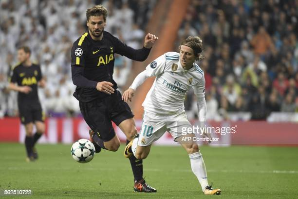 Tottenham Hotspur's Spanish striker Fernando Llorente vies with Real Madrid's Croatian midfielder Luka Modric during the UEFA Champions League group...