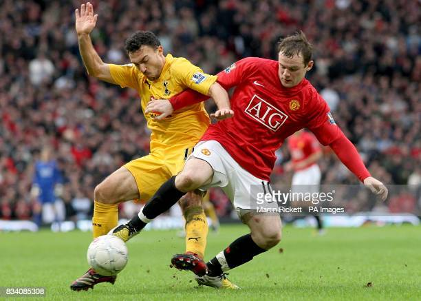 Tottenham Hotspur's Steed Malbranque and Manchester United's Wayne Rooney battle for the ball
