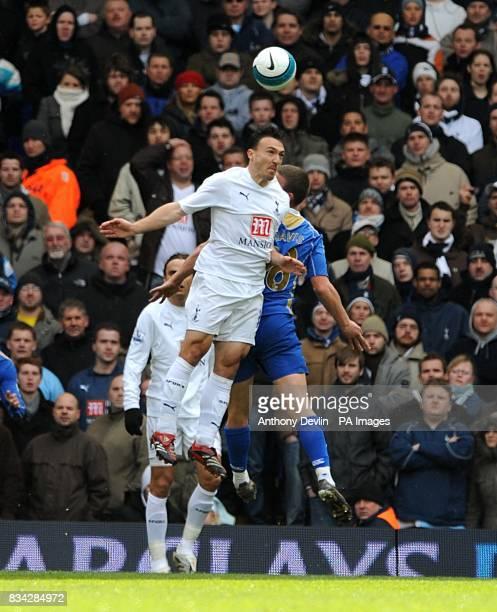 Tottenham Hotspur's Steed Malbranque rises high for the ball against Portsmouth's Sean Davis