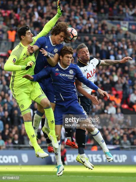 Tottenham Hotspur's Toby Alderweireld battles for the ball against Chelsea's Marcos Alonso Chelsea's David Luiz and Chelsea goalkeeper Thibaut...