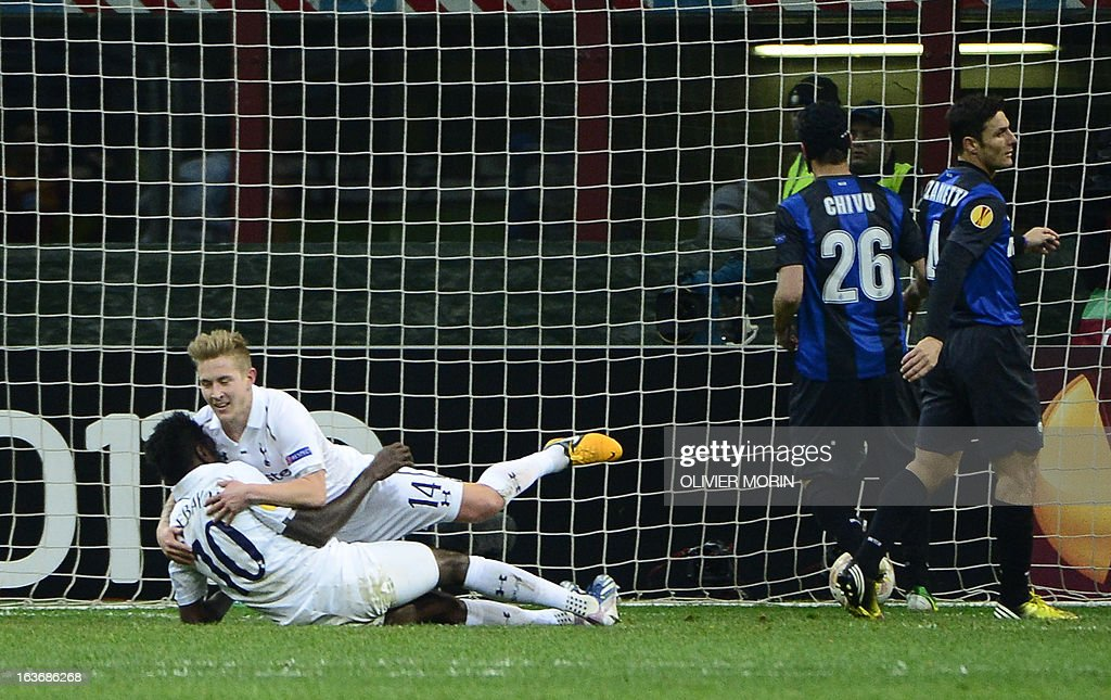 Tottenham Hotspur's Togolese striker Emmanuel Adebayor (Lbottom) celebrates with teammate after scoring during the European Cup football match between Inter Milan and Tottenham, on March 14, 2013 at the San Siro stadium in Milan.