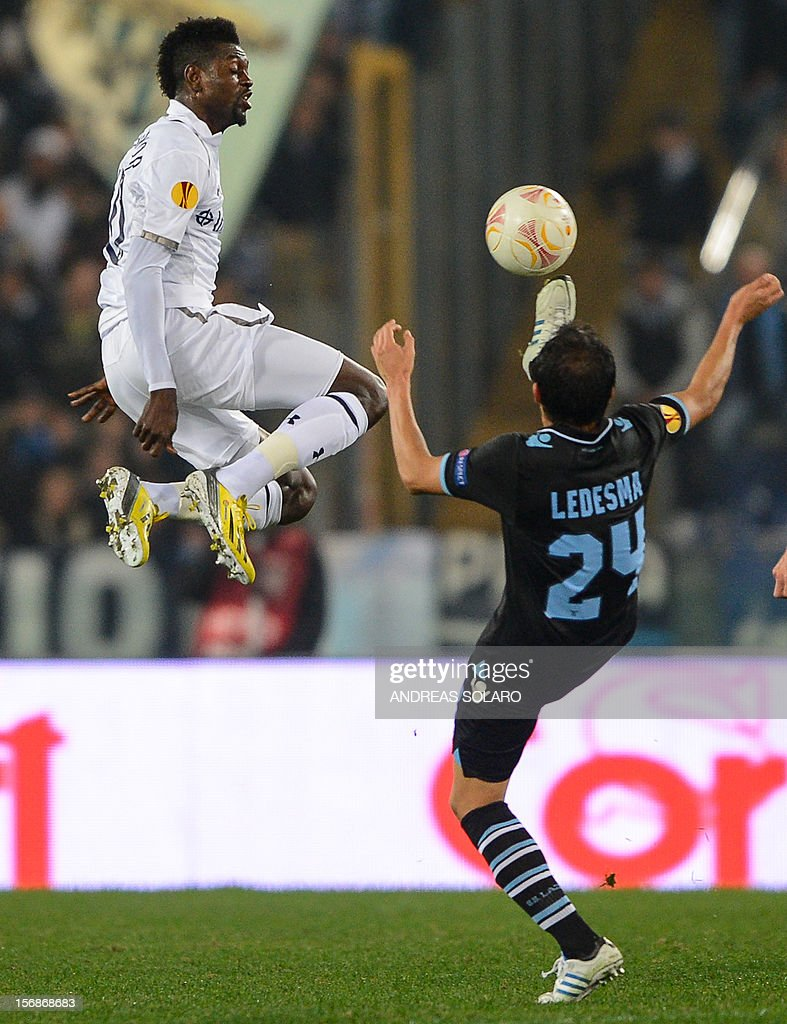 Tottenham Hotspur's Togolese striker Emmanuel Adebayor (L) fights for the ball against Lazio's Argentinian midfielder Cristian Ledesma during the group J Europa League football match between Lazio and Tottenham on November 22 , 2012 at the Olympic stadium in Rome.