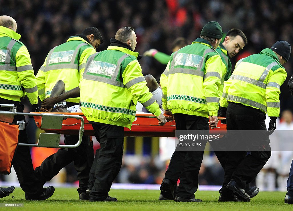 "Tottenham Hotspur's Togolese striker Emmanuel Adebayor leaves the field on a stretcher during the English Premier League football match between Tottenham Hotspur and Arsenal at White Hart Lane in north London on March 3, 2013. USE. No use with unauthorized audio, video, data, fixture lists, club/league logos or ""live"" services. Online in-match use limited to 45 images, no video emulation. No use in betting, games or single club/league/player publications"