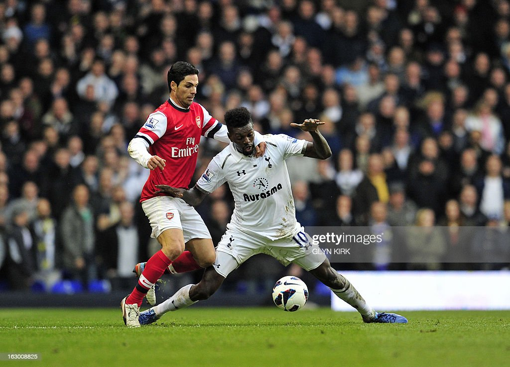 """Tottenham Hotspur's Togolese striker Emmanuel Adebayor (R) vies with Arsenal's Spanish midfielder Mikel Arteta (L) during the English Premier League football match between Tottenham Hotspur and Arsenal at White Hart Lane in north London on March 3, 2013. USE. No use with unauthorized audio, video, data, fixture lists, club/league logos or """"live"""" services. Online in-match use limited to 45 images, no video emulation. No use in betting, games or single club/league/player publications"""